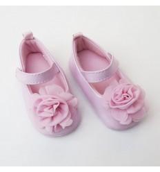 Zapato rosado con flor